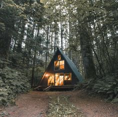 This would be a dream! House in the woods. Green home.