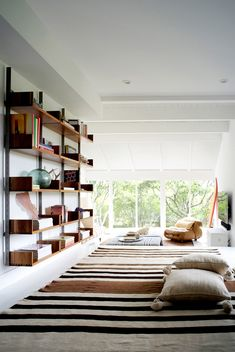 shelving + rug + floor pillows....