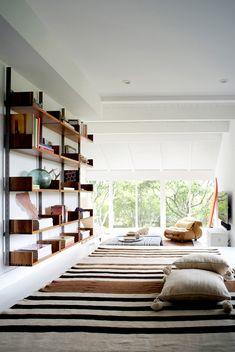shelving + rug + floor pillows....