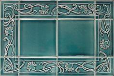 """Bachelor Button Border Architectural Tile. All of our handmade tiles may be used for architectural installations. Border designs may be used in combination with the 3 or 4 in. decos, field tiles or with the 6"""" Art Tiles. Tiles may also be used in outdoor applications. All tiles are approximately 9/16"""" thick. (See website for prices.)"""
