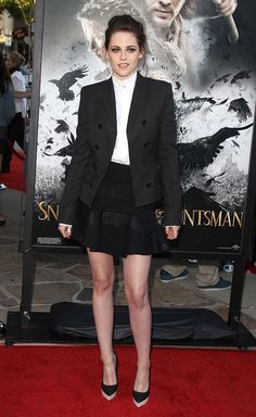 """Kristen Stewart rocked an equestrian-like look upon arriving at a """"Snow White and the Huntsman"""" industry screening in L.A. on Tuesday night. The 22-year-old actress -- who was outfitted by designer Stella McCartney -- paired a high-collar blouse with a black blazer and matching mini skirt. A loose updo, smokey eye makeup, and two-tone platform pumps completed her youthful yet chic ensemble."""