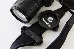 Lens Cap Holder and Filter Holders front and back on a camera strap.