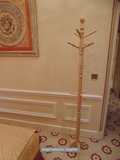 Lot 1066 - A tri-form base wooden robe stand / coat stand 1800mm tall