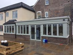 in Painswick French doors on a beautiful conservatory Window Design, Conservatory, Windows And Doors, French Doors, New Homes, British, Colours, Garden, Outdoor Decor