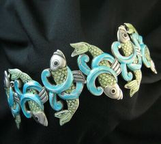 Discount Jewelry Margot de Taxco enamel and sterling silver 'Fish and Waves' bracelet, to 1978 - Enamel Jewelry, Sterling Silver Necklaces, Jewelry Art, Sterling Silver Jewelry, Jewelry Design, Silver Bracelets, Jewelry Ideas, Silver Earrings, Stone Jewelry