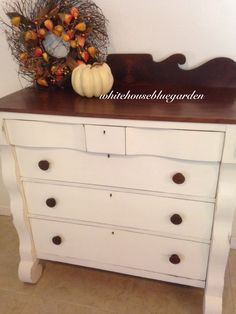 Look at all the curves on this Empire. Painted in Oyster chalk paint and stained top.  Original wood knobs.