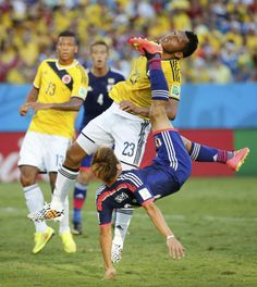 Japan's Yoshito Okubo tries to score past Colombia's Carlos Valdes during their 2014 World Cup Group C soccer match at the Pantanal arena in Cuiaba June REUTERS/Eric Gaillard World Cup Groups, Soccer Match, World Football, World Cup 2014, Cool Style, Battle, June 24, Japan, Brazil
