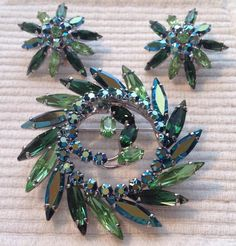 Sherman brooch with earrings emerald , light green and emerald AB . Rhodium plated