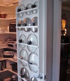 Use the back of your pantry door to store pot lids.