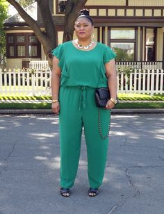 Plus size fashion blogger Kiah of fromthereztothecity.blogspot.com wearing DKNYC jumpsuit.