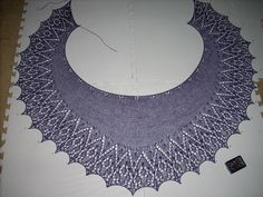 Pleasance crescent shawl by SusannaIC. Pattern to purchase, find on ravelry or I think her website, Artqualia Designs.