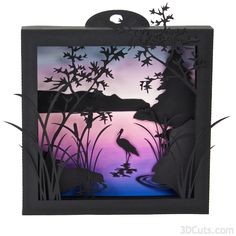"""This download contains the cutting files for this 4 layer shadow box  featuring a heron wading in the lake reeds. The finished shadow box is  about 6.5"""" square. The file pieces fit on 8.5 x 11"""" card stock.  Construction skills are basic 3d techniques and easy but the cutting skill  for the detail layer requires an understanding of detail cutting using your  machine. Construction directions can be found at  http://3dcuts.com/heron-cove-tutorial.Also included are four different  backgrounds…"""