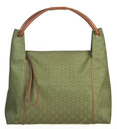 Gucci Green And Monogram Canvas Handbag Hobo Bag. Hobo bags are hot this season! The Gucci Green And Monogram Canvas Handbag Hobo Bag is a top 10 member favorite on Tradesy. Get yours before they're sold out!