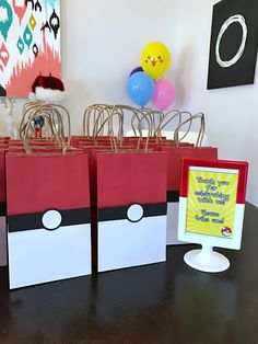 Poke Ball favor bags for a Pokémon-themed birthday party. Click or visit FabEveryday.com to see details and DIY instructions for a Pokémon or Pokémon Go themed kid's party, including printables, food, decorations, favors, and party activities.