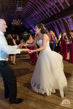 Amy and Peter enjoying their reception at the Barn.  Photo courtesy of @ssuttonphoto.