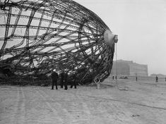 Members of the U. Navy Board of Inquiry inspect the wreckage of the German zeppelin Hindenburg on the field of the Lakehurst Naval Air Station in New Jersey, May Photo: Associated Press File Photo / 1937 AP Paros, Rare Historical Photos, Gothic Architecture, Air Travel, Tour Eiffel, Dieselpunk, Photos Du, Our Lady, Belle Photo