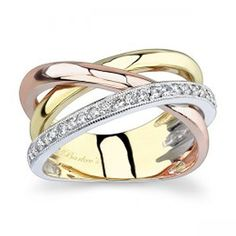Modern contemporary styling gives this ring an air of elegance. Three bands rise from the white gold shank and artfully criss-cross over the shoulders. One band is yellow gold, one band is rose gold and one is white gold with pave-set diamonds adorning i Black Diamond Bands, White Gold Diamonds, Rose Gold, Bling Bling, Wedding Rings Solitaire, Engagement Rings, Womens Wedding Bands, Wedding Jewelry, Gold Wedding