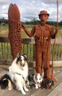 Big Fish (statue) with a rough collie, miniature dachshund and cardigan welsh corgi dogs, Raymond, Washington
