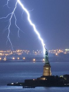 Photographer Jay Fine snapped this photo of the Statue of Liberty being struck by lightning after waiting two hours through a blustery storm. Fun fact: Lady Liberty gets hit by lightning about 600 times a year. Who knew? Cool Pictures, Cool Photos, Beautiful Pictures, Amazing Photos, Crazy Photos, Random Pictures, Nature Pictures, Natural Phenomena, Natural Disasters