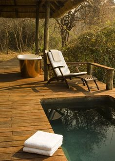 Lovely deck, bathtub, pool, comfortable sun lounger. Anything missing?  Don't forget to share your thoughts in the comments section! on The Owner-Builder Network  http://theownerbuildernetwork.co/wp-content/uploads/2012/12/0baa6589e86ab62e39295b9b042d8837.jpg