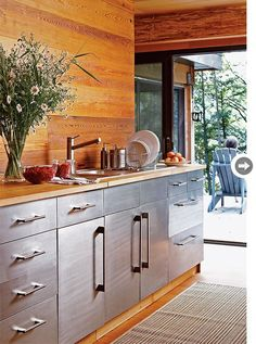 Simple kitchen - indestructible cabinets... Fingerprints? - and love the long, uncluttered countertop