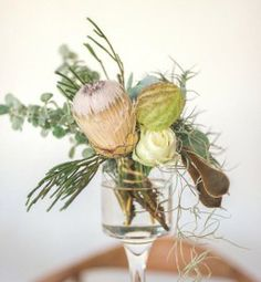 This is the most amount of flowers & branches in a vase - less is more