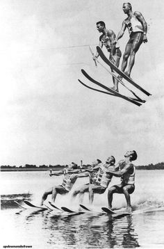 """A high speed water skiing team demonstrate the """"flying high and dry"""" stunt at the Cypress Gardens in Florida. November, 1965."""