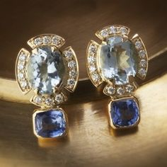 Sapphire blues diamond ear studs - Classic pair of diamond earrings featuring blue sapphires and blue topaz are handcrafted in 18k gold.