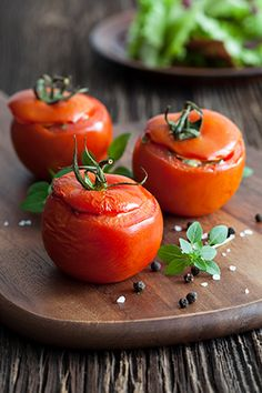 filled tomatoes on a chopping board