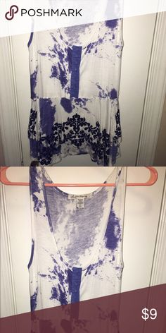 American Rag Peplum Tank Sin he's at the waist to emphasize your curves and is really soft to the touch! It's design also includes almost a purple tie dye like effect with flowers. American Rag Tops Tank Tops