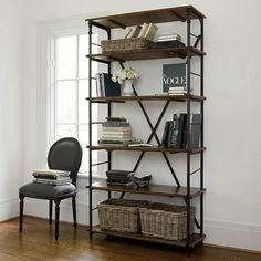 This ingeniously designed Tall Bookcase epitomizes the best in French Industrial styling. Iron posts have decorative castings and hidden notches in the back, so you can adjust the shelves and book guards to fit the height of your books. Toulouse Tall Bookcase features:4 adjustable shelves Solid mango wood Riveted metal corner bracketsX back supports Antique Walnut stain finishAssembly Required