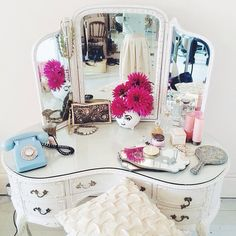 Love the shape of this vanity table and the glass top.