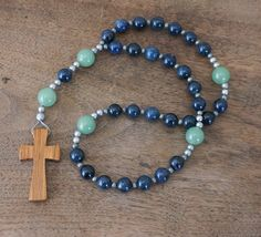 Beautiful Christian Prayer Beads made with natural blue & green gemstone beads, a wooden cross and antiqued silver accents  Each of my prayer bead strands are designed and handcrafted by me with top quality components and a meticulous attention to detail. They are meant to support a spiritual purpose; intended for prayer and meditation, strength for life challenges, faith, and spiritual growth.  This rosary features: ♦ a simple wood cross ♦ Invitatory / Cruciform beads: natural green...