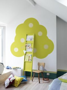 super cute wall art / bookshelf tree in a kid's room