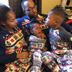 A family in matching Nordic Winter and Cozy Cottage onesies from Snug As a  Bug. 7e035e51c