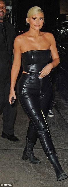 97affd0915e Hell for leather: Kylie wore a matching top and trousers with flat boots  for the