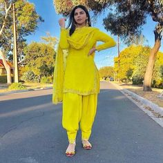 Image may contain: 1 person, standing and outdoor Punjabi Suit Neck Designs, Patiala Suit Designs, Salwar Designs, Kurti Designs Party Wear, Yellow Punjabi Suit, Punjabi Suit Simple, Yellow Kurti, Salwar Suits Simple, Yellow Lehenga