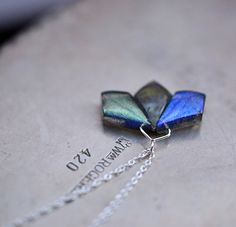 These stones are so beautiful! Three geometric shaped labradorites are bound together to create a partial flower, and each one has its own