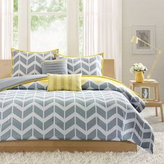Add a fun and contemporary vibe to your bedroom with the Elle five-piece comforter set from ID-Intelligent Design. With a fun chevron print, this soft bedding set brightens up your bedroom with a play Comforter Sets, Yellow Comforter, Purple Duvet, Teal Bedding, King Size Bedding Sets, Grey Comforter, Duvet Bedding, Decorating Rooms, Interior Design