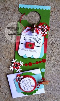 Christmas door hanger by Susan Liles. Reverse Confetti stamp set: North Pole Wishes. Confetti Cuts: North Pole Wishes, Hanging Out, Circle Garland, Let It Snow, Envie Wrap and Tag Me, Too. Christmas.
