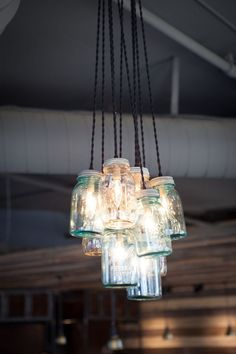 Rustic chandelier - Mason jars id like this out of a whiskey barrel