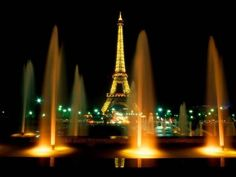 Paris at night- buy a bottle of wine as a souvenir to commemorate trip to paris year