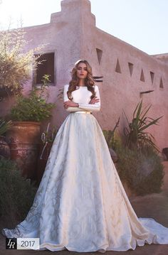 Asia, Desert Mistress 2017, Extraordinary Jacquard wedding gown with golden belt and buttons. Full skirt falls to floor. Beautiful bow on the back