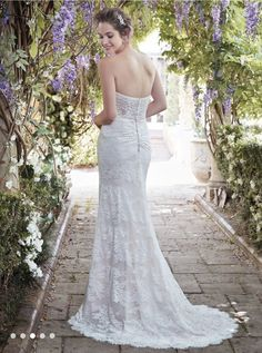 Octavia Romantic allover lace contrasts beautifully against Ava Satin in this classic sheath wedding dress, featuring a strapless sweetheart neckline and illusion scoop back accented in soft lace. Finished with covered buttons and zipper closure. Sheath Wedding Gown, Bridal Wedding Dresses, Designer Wedding Dresses, 2017 Wedding, Wedding Bells, Dream Wedding, Covered Buttons, Maggie Sottero, Wedding Ideas