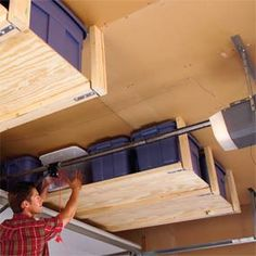 Suspended garage ceiling shelving. Each shelf holds 8 storage totes and about 160 lbs. diy-for-the-home