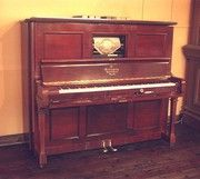 Antique Pianola once owned by Liberace Condition: perfect Material: Mahogany Circa 1898