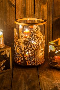 Retiring soon gorgeous PartyLite Golden Frond Hurricane candle holder! Ornate golden fronds embellish a clear glass hurricane topped with a removable golden metal rim. Love it in my living room!