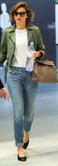 Who made  Miranda Kerr's black sunglasses, brown handbag, and sunglasses?