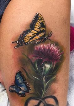 Realistic color butterflies with thistle flower. Ryan Mullins Art Junkies Tattoo by Ryan Mullins Butterfly Tattoos Images, Butterfly With Flowers Tattoo, Butterfly Tattoo Meaning, Butterfly Tattoo Designs, Flower Tattoos, Butterflies, Scottish Thistle Tattoo, Scottish Tattoos, Leg Tattoos