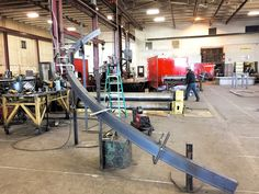 "6"" steel channel rolled for spiral staircase stringers.  One is rolled flanges in and one flanges out to mate up on this stringer.  Rolled at Longero in Denver, Colorado."